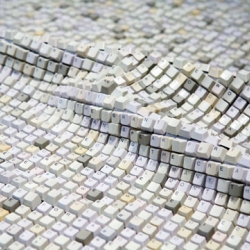 In Jean Shin's interactive sculpture, thousands of recycled keyboard keys are embedded into a continuous textile.