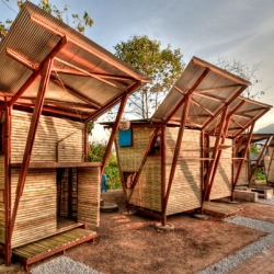 These sustainably-built bamboo butterfly huts were designed by humanitarian design organization TYIN Tegnestue to provide housing for 24 orphans in Thailand