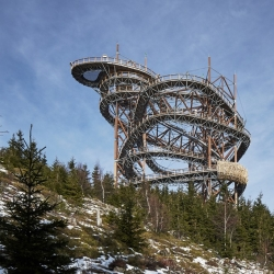 A 101-metre slide winds down through this 55-metre high structure designed by Brno-based studio Fránek Architects on a mountain in the Czech Republic.