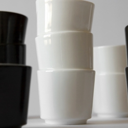 What appears to be two or three cups nestled within each other is actually only one cup. Stacked Cups from the. are available in white and black, and come in a set of triple, double, and single size cups.