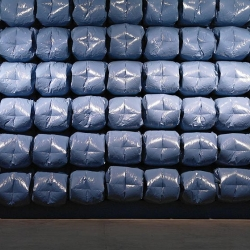 Ninety Six by Nils Völker - The plastic bags are selectively inflated and deflated in controlled rhythms, creating wavelike animations across the wall.