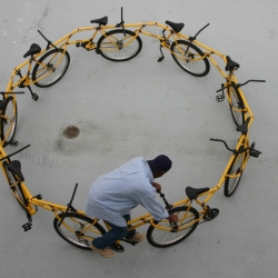 Nine salvaged bikes were reassembled into a carousel formation. The bike is modular and can be dismantled and reassembled. It is normally left in public places where it can attract a variety of riders.