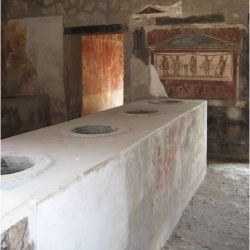 After an almost two thousand year hiatus, one of Pompeii's famous fast food shops - known as a thermopolium - is to re-open.  Kuriositas has the story.
