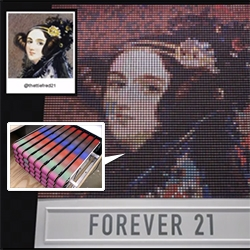 Forever 21's Thread Screen by Breakfast NY - more interesting is looking behind the scenes. There are 6400 wooden spools that seem to have colored strips rotated on them acting like pixels to show off Instagram images.