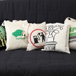 Tote Bags as Throw Pillows! A NOTCOT Experiment... i have too many awesome tote bags that suck as tote bags, but seems like they might make great throw pillows instead... new way to reuse your reusable bags?