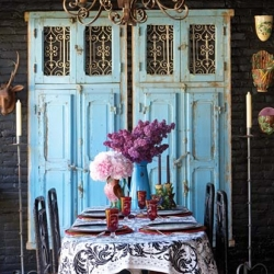 Doors hung on the walls - flowers planted on the roof - just a few of the design inspirations at this antique Vermont farmhouse