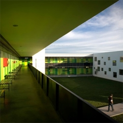 Colorful interior courtyards with perforated volumes  give character to the San Sebastian high school in Chile, designed by Tidy Arquitectos.