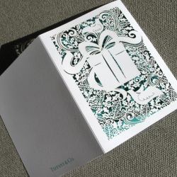 Tiffany & co. Holiday card 2012. The original artwork was hand cut in paper by Sara Burgess and then laser cut for production.