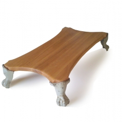 confused-direction designed a rugh luxe table with feet from old bathtubes and oak from old tables.....