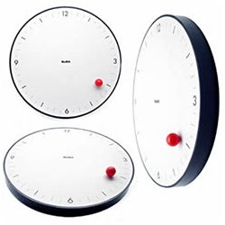 """A seemingly gravity-defying ball travels around the dial to mark the time, creating an eye-catching illusion.""  I want one!"