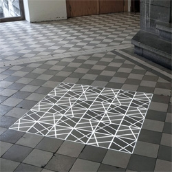 Time Tilings by Pablo Valbuena is a set of four site-specific video projections on tiles. The simplicity and speed of the animation creates a mesmerizing effect.