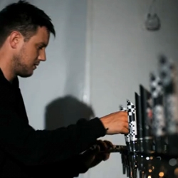 DJ Cheeba performs an exclusive live mix using Beck's Vier beer taps to trigger audio samples and lighting effects across a grid of 600 LED-lit Beck's bottles.
