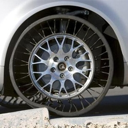 Tweel tires by Michelin use no air and therefore cannot burst or become flat. (From like 5 years ago?)