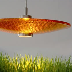 Greenlight Concepts creates retro-modern lighting fixtures using glass lenses recycled from discarded traffic lights.