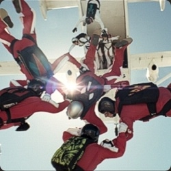 "19 skydivers spelled out the word Honda in three minutes and 20 seconds for UK's first live tv promo, inspired by the car manufacturer's new advertising strapline: ""Difficult is worth doing"""