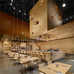 The Toast Restaurant in San Francisco, located inside a shopping center, brings a fresh interior design thanks to the random perforation on the wall panels. Designed by Natoma Architects.