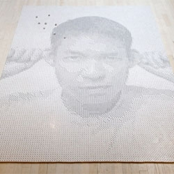 Frederick McSwain's portrait of Tobias Wong made with 13,138 dice (one for each day of his life).