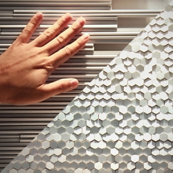 Mutina's 'Phenomenon' tile system by Tokujin Yoshioka designed to integrate small substances and produce both depth and expanse.
