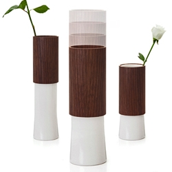 Nice and smart idea. KASVU Extendable vase by Tonfisk. The height of the vase can be adjusted by a moving rubber ring along the body of the porcelain part upon which the wooden part then rests.