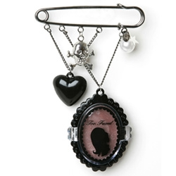 "As we watch the charms and skulls and black hearts trickle down ~ latest is the Too Faced ""brooch"" with lip gloss..."