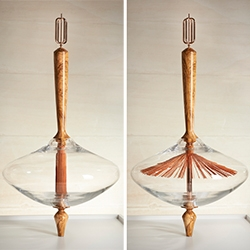 Stephanie Langard's La Toupie - a beautiful wood and glass spinning top. When you spin it the tassel lifts up!