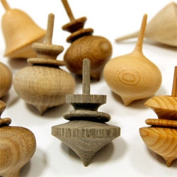 These Japanese wooden spinning tops are all unique ~ and some even have floating rings carved out of them... See the videos of them in action!!!