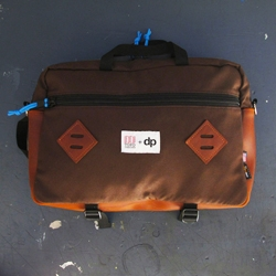 Doane Paper has teamed up with TOPO designs to collaborate on a rustic mountain briefcase.