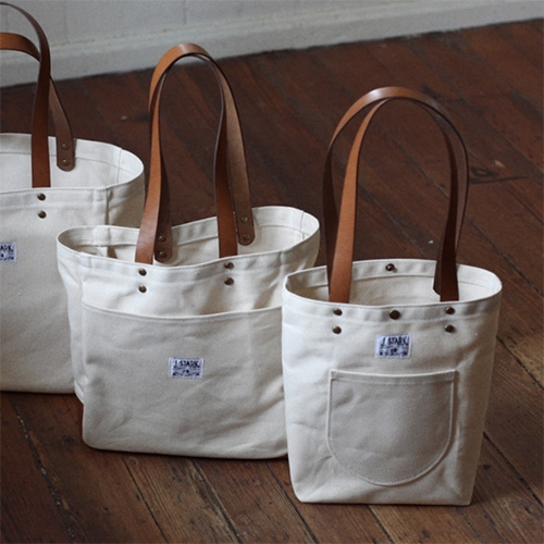 J. Stark Tote Bags by Erik Holmberg in Charleston. There's nothing quite as timeless as a clean all purpose tote, but i love the details like the curved outer pocket of the Auburn - also the leather based Horace.