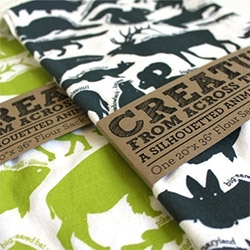 Peppersprouts' Kitchen Tea Towels that teach you one of each 50 states' animals (fish, bug, bird, or mammal, etc)! In lime and dark blue on white...