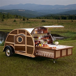 Bulleit Frontier Whiskey Woody-Tailgate Trailer by Brad Ford - sleek leather furnishings and wood finishings (reclaimed Bulleit Bourbon casks), elegant glassware, and a full entertainment system, and 1year supply of Bulleit Bourbon and Bulleit Rye.