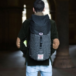 Krukke Backpack, designed to be versatile and adaptable for any expedition. The Krukke is made of harris tweed and passion, as comfortable on two wheels as it is on two feet.