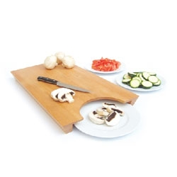The Transfer chopping board from chris&ruby lets you easily move your chopped items onto a plate.