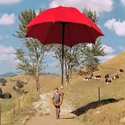 35-foot red umbrella, coming to the rescue of people in need... delivery... beautiful ad for travelers insurance... by fallon usa...