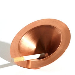 Spin Ashtray by Tomás Alonson for Ace Hotel London. Made of pressed, untreated copper.
