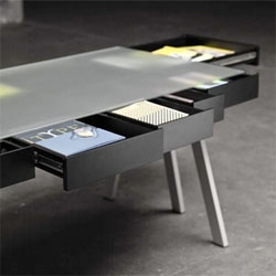 Treasury table by Lucie Koldová and produced by Process. A frosted glass surface covers a plethora of drawers.