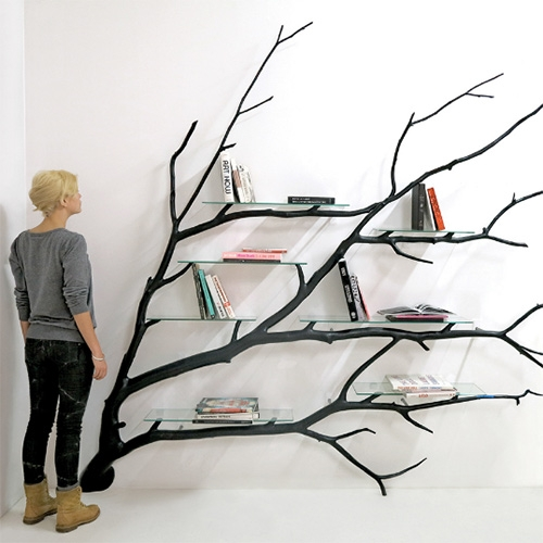 Bilbao Tree Shelf - Fallen tree branch converted into shelf by artist Sebastian Errazuriz. The branch was found on a road and then reshaped to fit as a shelf. Errazuriz then applied black lacquer to give it a smooth and shiny finish.
