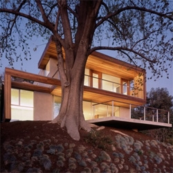 A contemporary house in Silver Lake, CA. Designed by Standard, a simple space with a great view is wrapped by warm materials. I like the existing tree on the site and how it shades the terrace.