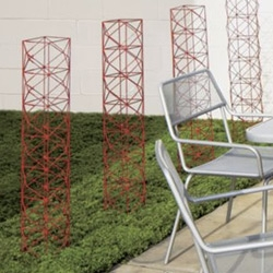 CB2 kiss garden sculpture could be fun as to grow plants on.... cute for vines or tomatoes?