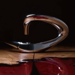 The futuristic water tap by Zaha Hadid with her signature curvilinear aesthetic sense.