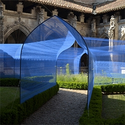 Paris studio Atelier YokYok created the Les Voûtes Filantes – or The Shooting Vaults – a string installation within the 16th-century Gothic-style cloister at St Stephen's Cathedral in Cahors, south-west France.
