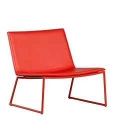 CB2's triumph lounge chair in monochromatic hot-rod red.