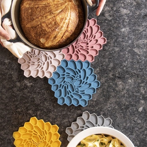 Nervous System Hive Trivets are back! A modular silicone rubber trivet featuring an organic embossed pattern inspired by cellular forms. Extra fun tiled together!
