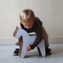 I don't normally advocate gifting Trojan horses, but this little one is too cute not to share. By Alex Hellum for Kidsonroof, this recycled cardboard horse can be a toy and a stool.