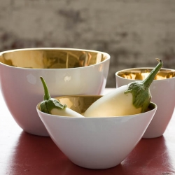 Gold and the holidays seem so natural together.  This set of gold glazed bowls by a talented Parisian duo would make an excellent holiday gift for that person who seems to have everything.