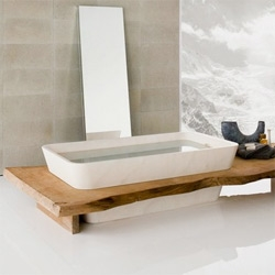 Matteo Thun for Neutra has integrated nature into these modern sinks, vanities, countertops, benches, and check out the bathtub with the wood surround! Adding to their uniqueness, these pieces are made using Kauri wood.