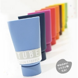 TubeDoorStopper is a silicone rubber paint tube as a door stopper. Of course its available in many different Pantone shades.