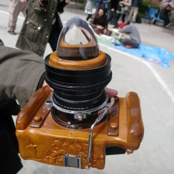 A homemade medium format camera complete with carved wooden body and 360 degree lens (that looks like a crystal ball). Caught on Tokyo Camera Style.
