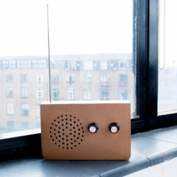 SuckUK together with designer Christopher McNicholl  produced a cardboard radio. The internals are housed in a simple card structure which can be recycled at the end of the product's life.""