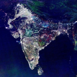 Satellite photo of India after dark, showing changes in illumination over 10 years. Areas marked white are lights present throughout the entire period.