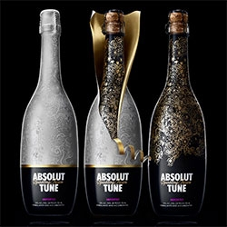 Absolut Tune is the latest from Absolut… a sparkling fusion of Absolut vodka and crisp white wine. Fascinating packaging ~ a double layered Tord Boontje-esque bottle wrap...